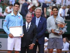 President of the French Tennis Federation is surrounded by champions: Bjorn Borg and Rafael Nadal. Sunday, June 8, 2014.