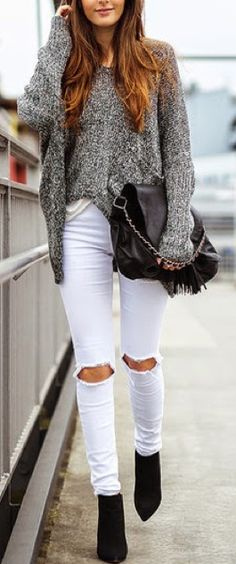 distressed white jeans, black tweed chunky sweater