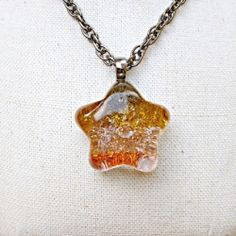 This chic pendant was made using items from the dollar store. Very easy craft to make!