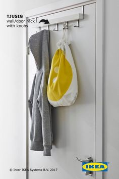 The IKEA TJUSIG wall/door rack with knobs has sturdy hooks that are perfect for hanging coats, bags, scarves, hats and anything else you may need as you head out the door.