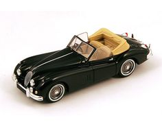 Spark Jaguar XK Resin Model Car This Jaguar XK 140 Drophead Resin Model Car is Black and features comes in a display case. It is made by Spark and is scale (approx. Jaguar Models, Corgi Toys, Jaguar Xk, Model Car, Diecast Models, Display Case, Old And New, Scale Models, Cars And Motorcycles