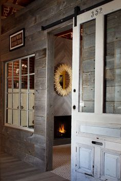 old exterior door repurposed as interior barn door  asdesiretoinspire.net - Artistic Designs forliving