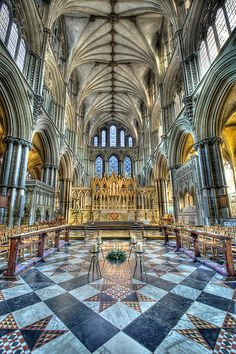 The Presbytery.    Ely Cathedral.    Built in the 13th Century to house the shrine of St Etheldreda. Behind the High Altar, the reredos depicts the events of the Holy Week from Jesus' entry into Jerusalem to his carrying the cross on Good Friday.