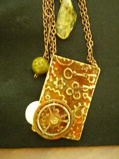 Steampunk style necklace. Copper stamped and inked with a few stone details.