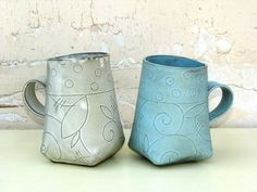Playful hand-built mugs beg to be held and stroked... -- Luna Vida Pottery