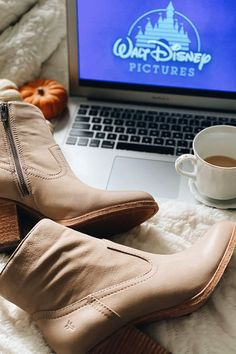 Made from tumbled Nubuck leather in a tight ankle silhouette, this pair of booties has an almond toe and Western-inspired Wellington.