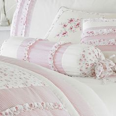 Vintage gingham and rose print bolster cushion.  http://www.worldstores.co.uk