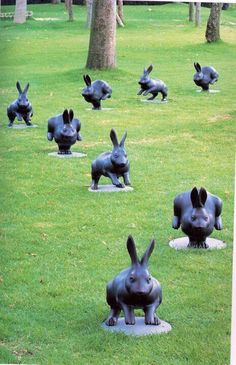 Unfortunately the original pin was taken off an image file and no information was given about who the wonderful artist who created these is, or where these delightful bunnies are located.