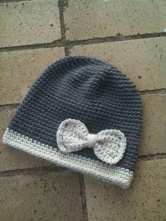 I could make this. Easy.   Crochet Bow Hat. $24.00, via Etsy.
