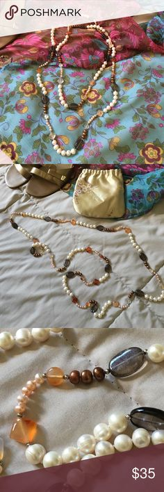 Beautiful pearl and amber bead necklace This gorgeous necklace has both creamy white pearls and smaller peachy ones with a variety of amber, brown and bronze beads.  It looks great as a single rope, knotted or doubled.  Given as gift but not my style. Jewelry Necklaces