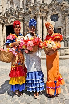 http://previews.123rf.com/images/macmonican/macmonican1402/macmonican140200033/25693448-HAVANA-CUBA-MAY-6-2009-Three-Cuban-women-in-traditional-dresses-in-Havana-Cuba-on-May-6th-2009--Stock-Photo.jpg