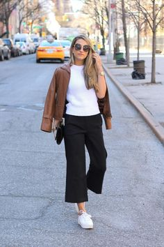 30 Ways to Wear Flatforms - over-the-shoulder brown leather jacket, a fitted white sweater, cropped black trousers, and white flatform shoes