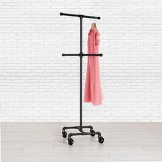 Industrial Pipe Clothing Rack by William Roberts Vintage This Pipe Clothes Rack is made using black pipe and pipe fittings. This extremely durable and long-lasting design is great for retail stores, trade shows, or extra closet hanging space at home. We love to make clothing racks custom for your