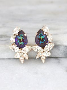 Purple Earrings, Peacock Earrings, Bridal Purple Earrings, Swarovski Purple Earrings, Bridesmaids Earrings, Gift For Her, Dark Purple Studs  Dazzling Cluster Crystal earrings feature a Marquise Pear cut shape crystals set on a secure prong settings. The perfect shade for cocktail parties or to add a touch of color to your wedding ensemble  Petite Delights is an Official SWAROVSKI® Branding Partner Our brand is legally licensed & authorized By Swarovski Company for high quality manufactur...