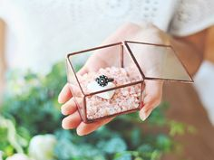 Fashion forward couples will be totally wowed by this incredible glass ring box by Waen at Etsy. If you're obsessed with rose gold weddings, then this is the box for you