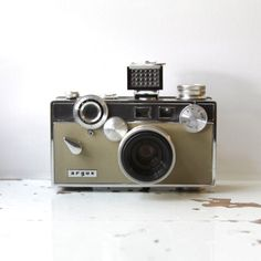 Vintage ARGUS C 3 Camera complete with Original Box, Instructions and Case C3 by impulseART on Etsy https://www.etsy.com/uk/listing/77275642/vintage-argus-c-3-camera-complete-with