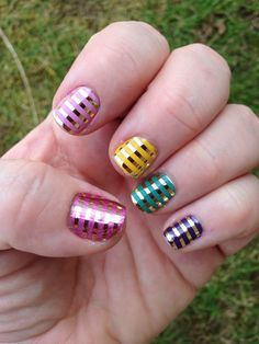 Custom Jamberry Nails manicure with a rainbow of colors! Gold Metallic Pinstripe wraps over five different Jamberry Lacquer colors!  Ask me how to get this look today! #MetallicGoldPinstripeJN #jamberrynails #LemonDropJN #LilacJN #RazzmatazzJN #IrisJN #MermaidJN #nailart #notd #manicure #nails #rainbow #shiny http://jocosjamz.jamberrynails.net