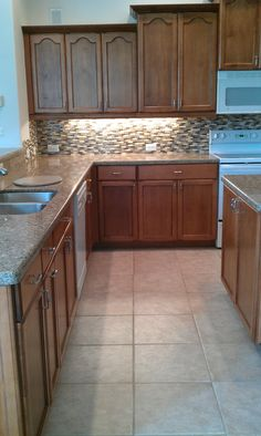 Finished Refacing  New Glass tile backsplash