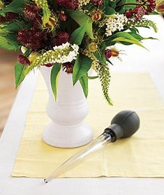 DIY BOUQUETS :: Change dirty water in a flower vase by using a turkey baster to suction up the liquid without disturbing your arrangement. Add fresh water directly from the tap. | #bouquets #realsimple #tips #vase
