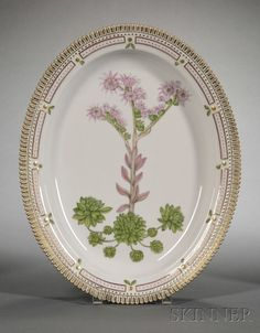 "Royal Copenhagen Porcelain ""Flora Danica"" Pattern Serving Platter, 20th century, oval, hand-painted with a highly realistic floral specimen, crenellated gilt edge."