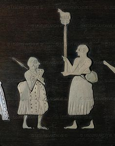 A soldier and a Mari dignitary who carries the standard of Mari. Detail of a victory parade, from the Ishtar temple, Mari, Syria. 2400 BCE Schist panel inlaid with mother of pearl plaques. Louvre Museum