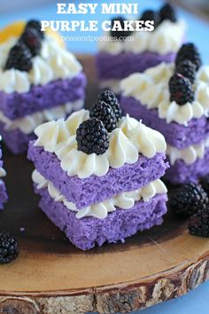 Vanilla Purple Cake with Lemon Buttercream is cut into mini individual cakes decorated with fresh blackberries, for a beautiful and tasty dessert. Highly adaptable, can be made any color and any flavor!