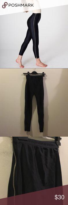 American Apparel Highwaist zipper leggings black Black nylon tricot leggings. Zippers down each side. High waist cut. Sold out at American Apparel! American Apparel Pants Leggings