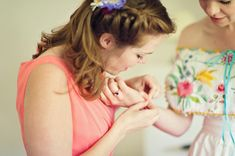Bridesmaid with blue flowers in her hair...