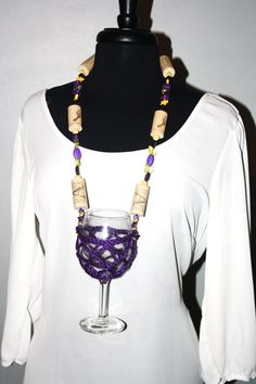 This playful wine glass necklace is an essential piece to all the ladies out there who are wine lovers and jewelry lovers! A full sized wine glass is the focal point for this funky and functional purple glitz necklace, with a crochet holder keeping that glass upright and safe.