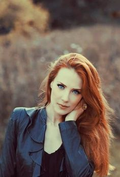 Red hair. Blue jacket. Stunning combo