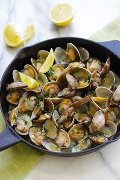 Sauteed Clams - Skillet clams with loads of garlic butter, white wine and parsley. The easiest sauteed clams recipe ever, 15 mins to make. from @rasamalaysia