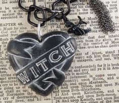 One Of A Kind Witch Tattoo Heart Necklace by Ugly by uglyartdotnet, $55.00   Jewelry  Necklace  Polymer Clay  ugly shyla dolls  uglyshyla art  witch necklace  strange weird odd  witchcraft jewelry American Horror  Coven  pastel goth  90\'s goth  black gothic rocker  pagan voodoo dark  supernatural black  black bird occult