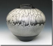 """Charles Riggs, one of """"3 Naked Raku Pots, 2003; dipped and polished terra sigillata; tophat raku kiln; slip resist (""""naked raku"""") method."""