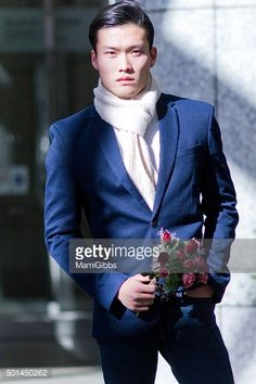 Stock Photo : Young man holding flower and waiting
