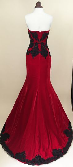 Stunning scarlet red and black lace ball gown, made with a rich red velvet with beaded black lace appliques.  The dress has a sweetheart neckline with structured fitted bodice and built-in bra, fully lined with duchesse sateen.