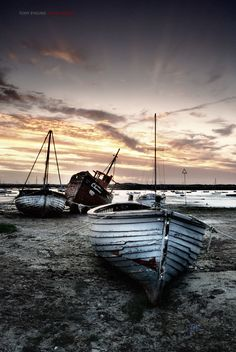 Boats at low tide, Mersea Island, Essex, England, UK