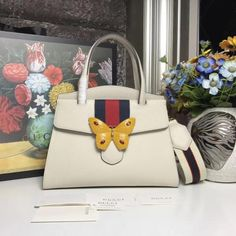 b9f689fc009 GucciTotem medium White top handle bag