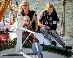 Dutch King Willem-Alexander and Queen Maxima and their three daughters Princess Amalia, Princess Alexia, Princess Ariane and Princess Beatrix, Princess Mabel, Countess Luana and Countess Zaria sail along on their private ship The Green Dragon (Groene Draeck) during Sail 2015 in Amsterdam, The Netherlands on August 22, 2015.