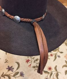 "HATBAND IS 3/4"" WIDE, NICKELS ARE 7/8"" wide. THIS IS A BEAUTIFUL DARK RUSSET BROWN FLAT BRAIDED BUFFALO LEATHER WESTERN HAT BAND ! BOLO STYLE WITH 11 GENUINE BUFFALO NICKEL CONCHOS ALL AROUND! THE LAST PIC IS DARK BROWN BUFFALO, you must specify if you want this color. 