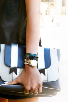 Sailor stripe clutches make a fresh transition into fall. Kelly Stuart  - ELLE.com