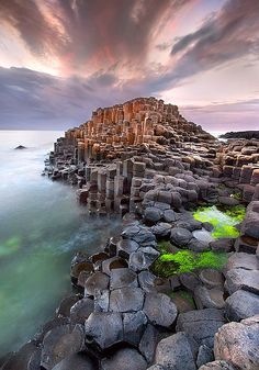 The Giant's Causeway, Ireland. An area of about 40,000 interlocking basalt columns up to 12m tall, the result of an ancient volcanic eruption. The tops of the columns form stepping stones that lead from the cliff foot and disappear under the sea. Most of the columns are hexagonal, although there are also some with four, five, seven or eight sides.