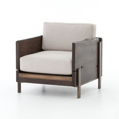 Wesson Woodrow Armchair  from the Abbott Collection from Four Hands Explore tailored looks and casual living with upholstered shapes in alluring linens, 100% hemps, and artful blends. The Khazana is a furniture store located in Austin, Texas