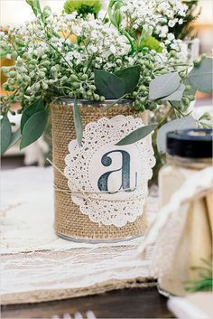 can with burlap and doillie with monogram #burlap #diywedding #weddingchicks http://www.weddingchicks.com/2014/03/17/shabby-chic-winery-wedding/