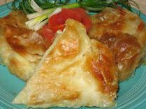 """Burek sa Sirom is a Serbian meat, cheese or vegetable pie made with flaky filo (also spelled """"phyllo"""") dough. There are myriad versions, including the coiled variety, among Bulgarians, Bosnians, Serbians, and others. And, of course, there are the famous triangle-shaped Greek spanakopitas. A slice of burek goes great with a glass of cold kefir.    Makes 6 servings of Cheese Burek  Prep Time: 30 minutes  Cook Time: 30 minutes  Total Time: 1 hour  Ingredients:        1 pound feta che"""