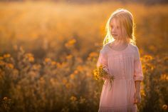 Portrait of a little girl in a field of yellow wildflowers. Photographed by Clare Ahalt Photography, a fine art portrait photographer located in Maryland, serving Maryland, Northern Virginia, Washington DC and Greater Baltimore. Photographed at a workshop held by Elena Shumilova Photography, photographed on location in Northern Virginia
