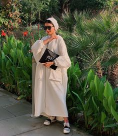 Image may contain: 1 person, standing and outdoor Modest Fashion Hijab, Modesty Fashion, Hijab Casual, Hijab Chic, Abaya Fashion, Muslim Fashion, Fashion Outfits, Hijab Gown, Hijab Outfit