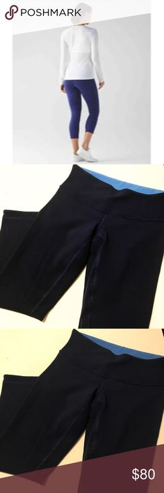 Lululemon Wunder Under Crop III Reversible Like new condition • Wunder under cropped fit leggings from Lululemon • Navy/emperor blue & light sapphire blue color • Wide soft waistband with hidden waist pocket • Waist: approximately 24 inches • Inseam: 21 inches • Length: 27.5 inches • No size tag! • According to lululemon website, best fit is for an XS between sizes 2-4 • Ask all questions before purchasing! lululemon athletica Pants Leggings