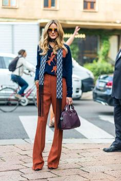 Olivia Palermo wearing Max & Co Boiled Wool Jumper with Insert in Midnight Blue Pattern, Max & Co Kick-Flare Crepe Trousers in Rust and Max & Co. Skinny Silk Scarf with Fringe