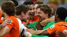 Netherlands players celebrate with goalkeeper Tim Krul (green) after he blocked two penalty kicks by Costa Rica in a quarterfinal shootout victory on Saturday at Fonte Nova Arena in Salvador, Brazil.