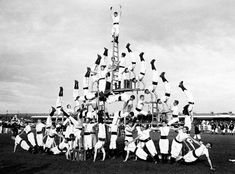 A Visual History of the Human Pyramid - Atlas Obscura Michigan Colleges, University Of Michigan, State University, Keio University, Human Pyramid, Cheerleading Pyramids, Old Photography, Italian Artist, Library Of Congress